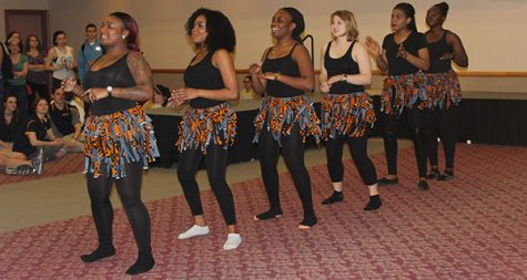 Students perform an African dance at the International Festival April 15 in the Cambria Room. The festival is an example of programming to promote racial inclusion.