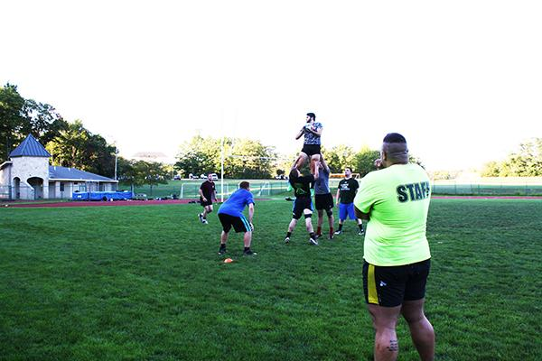 Head Coach Josh Horner runs through rugby drills with his team during practice Thursday, preparing them for their match against Saint Vincent College Sept. 23.