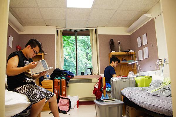 Freshmen Weijia Zhang (left) and Yihong Wang study in their Maple Hall room.