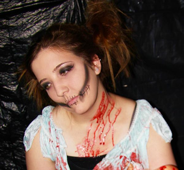 Sophomore Shelby Zastawa, a Phi Sigma Sigma sister, dresses up as a doll for the sorority's themed haunted house.