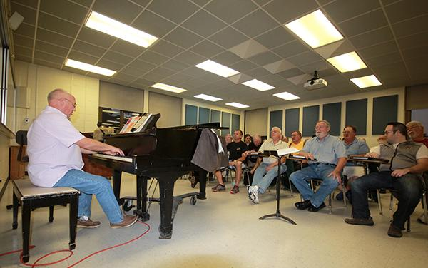 Samuel Louis Coco, Johnstown Symphony Chorus conductor, rehearses with singers.