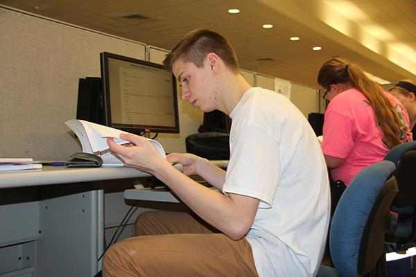 Sophomore Caleb Smith uses an Owen Library computer to review class notes.