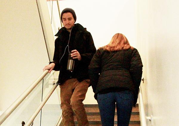 Senior Nick Dinofrio brushes shoulders with junior Niki Kusy as they pass each other on the Blackington Hall staircase.