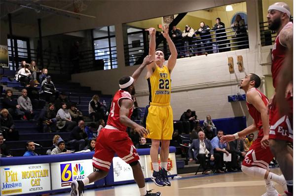 Pitt-Johnstown senior guard Jake Laravie attempts a 3-pointer on Feb. 4 against Edinboro University.