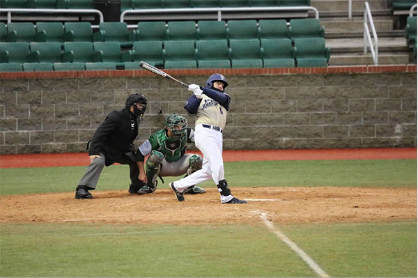 Pitt-Johnstown's Dan Clark swings at a pitch during a loss against Slippery Rock on April 1 at Point Stadium.
