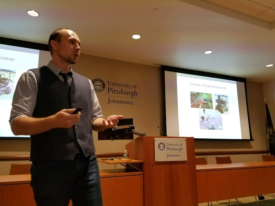 """Derek Leben gives a presentation about his book, """"Ethics for Robots: How to Design a Moral Algorithm,"""" Oct. 18 in the John P. Murtha Center."""