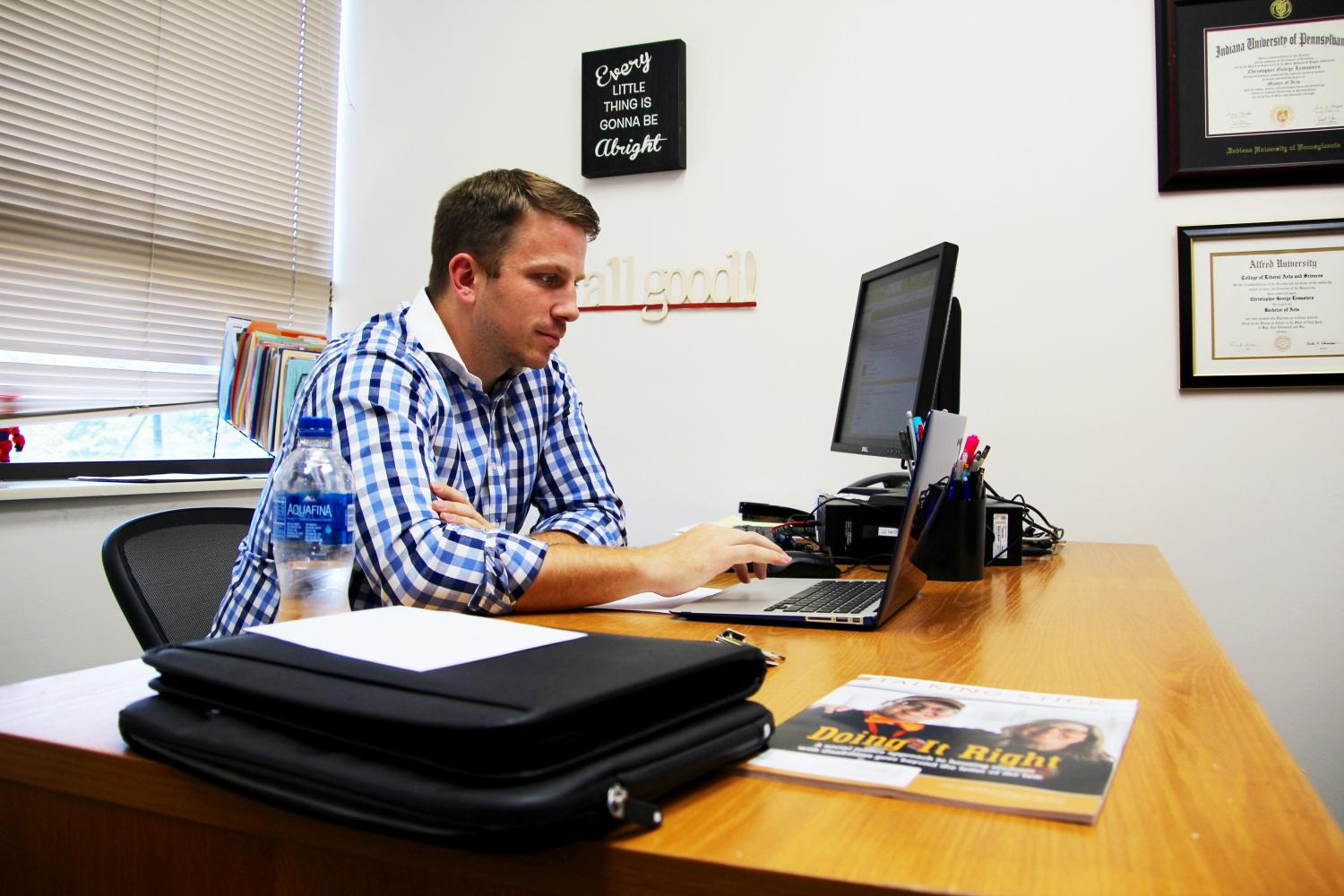 New Residence Life Director Chris Lemasters works at his desk in 130 Student Union. He began working at Pitt-Johnstown July 31.