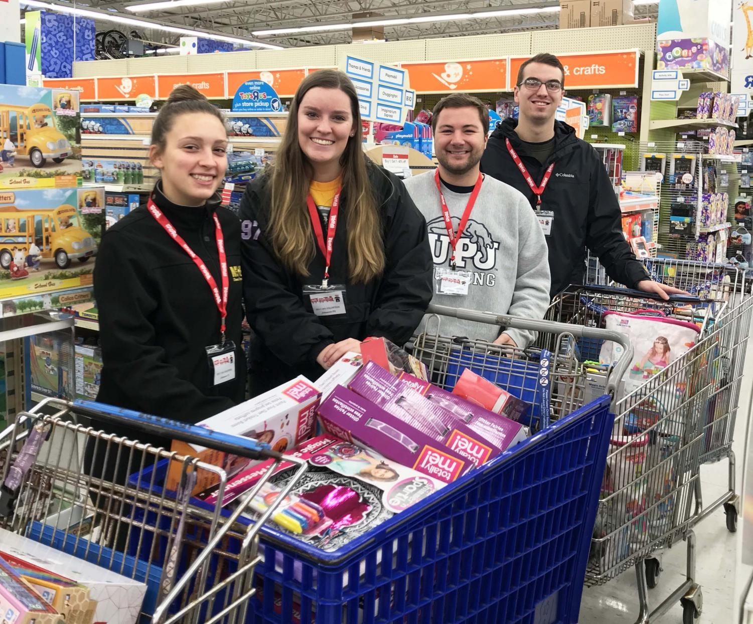 Student government members (left-right) Keirstin Ward, Gretchen Sheppard, Brady Willis and Joe Evanko particapate in a toy buy at Toys R Us Nov. 7