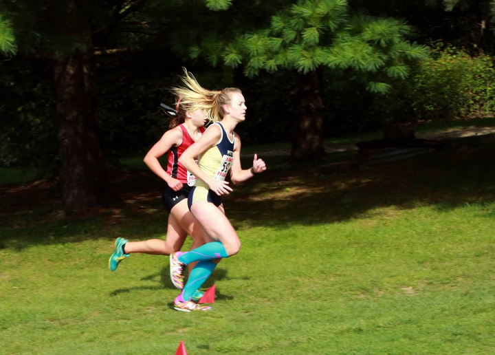 Pitt-Johnstown+cross+country+runner+Tori+Fulkroad+%28right%29+runs+at+the+Saint+Francis+University+Father+Bede+Cross+Country+invitational+at+Immegrun+Golf+Club+Sept.+1.+Fulkroad+finished+third+overall+with+a+20%3A31.9+time.+