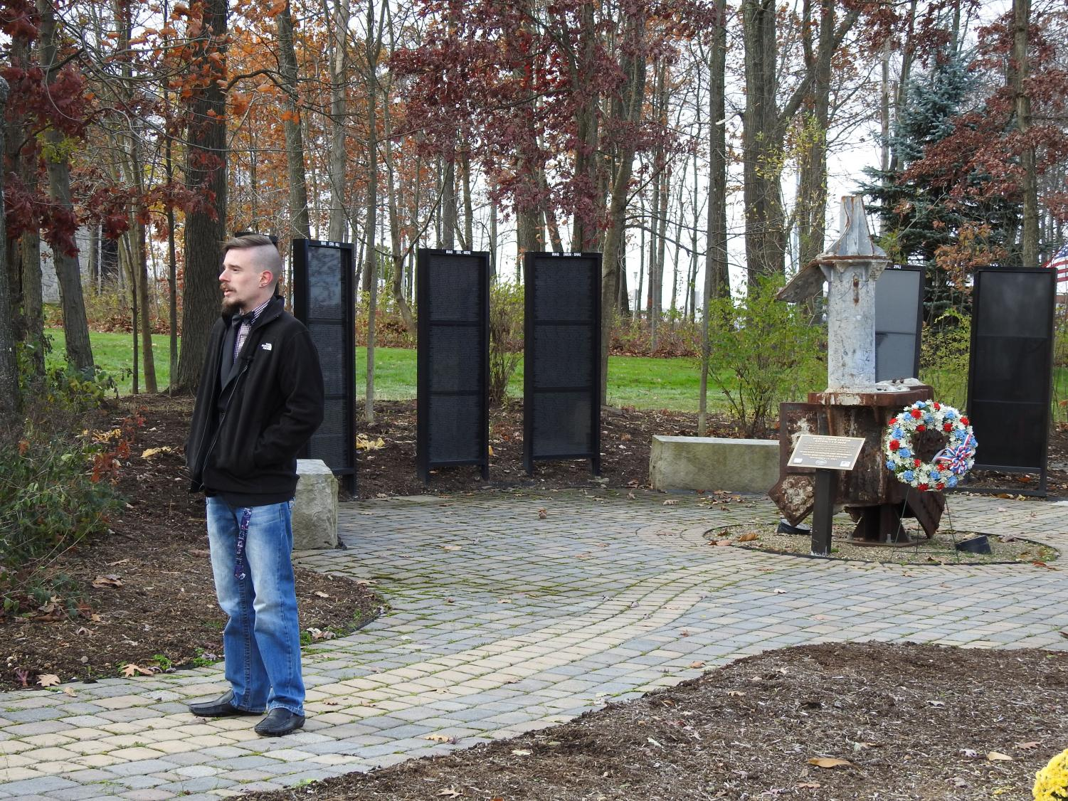 U.S. veteran  and Pitt-Johnstown student Cameron Carr stands in front of The Heroes Memorial near Whalley Chapel Friday.