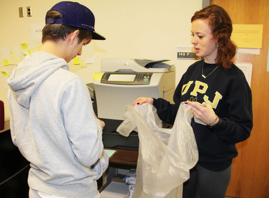 Bridge-transition+program+student+Justin+Gorden+and+Pitt-Johnstown+junior+Janna+Shober+collect+recycling+in+Biddle+Hall.+