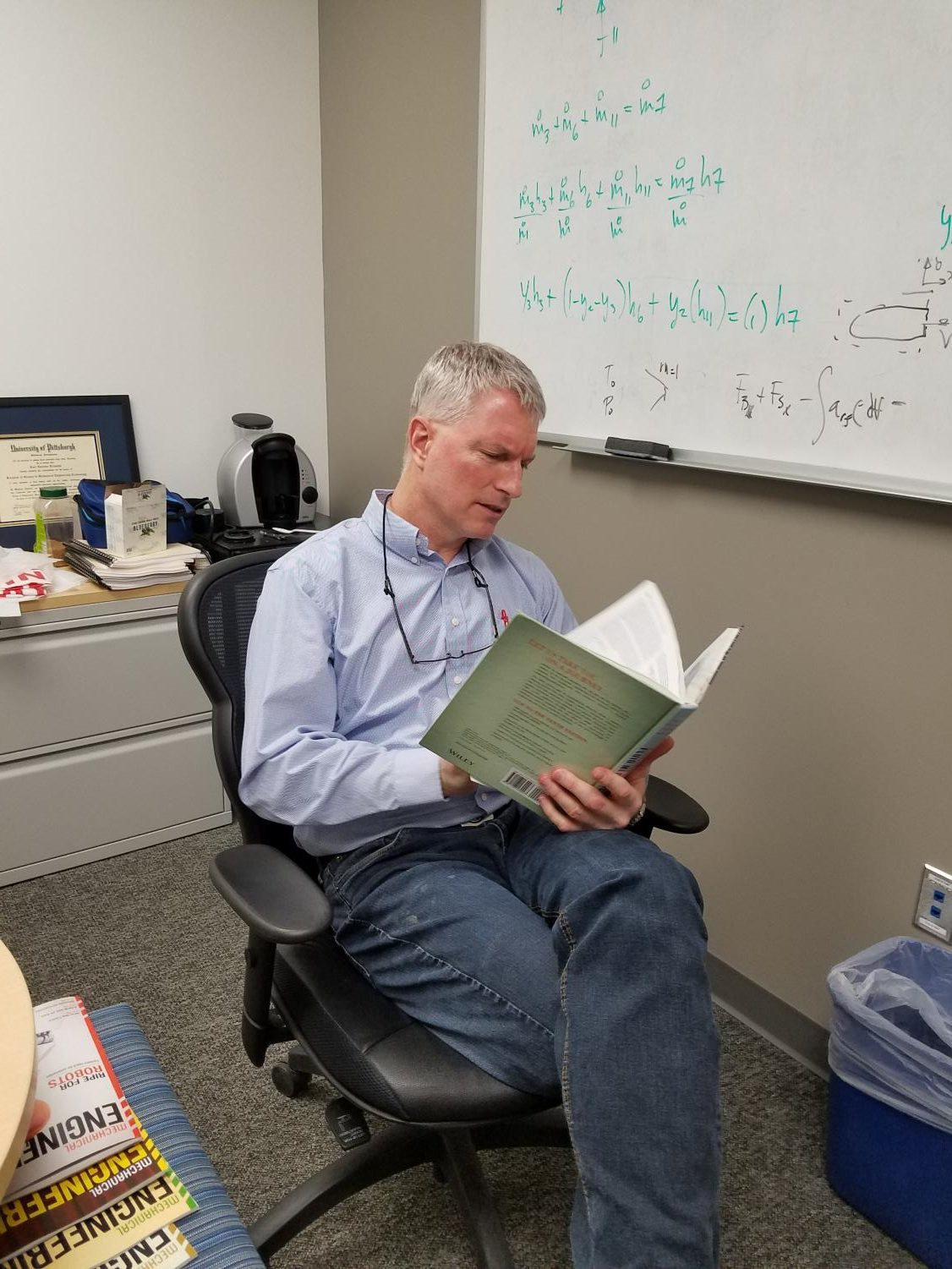 Mechanical engineering professor Kurt Klavuhn reads a fluid mechanics book. He leads the fluids review session for the Funamentals of Enigneering Exam this year.