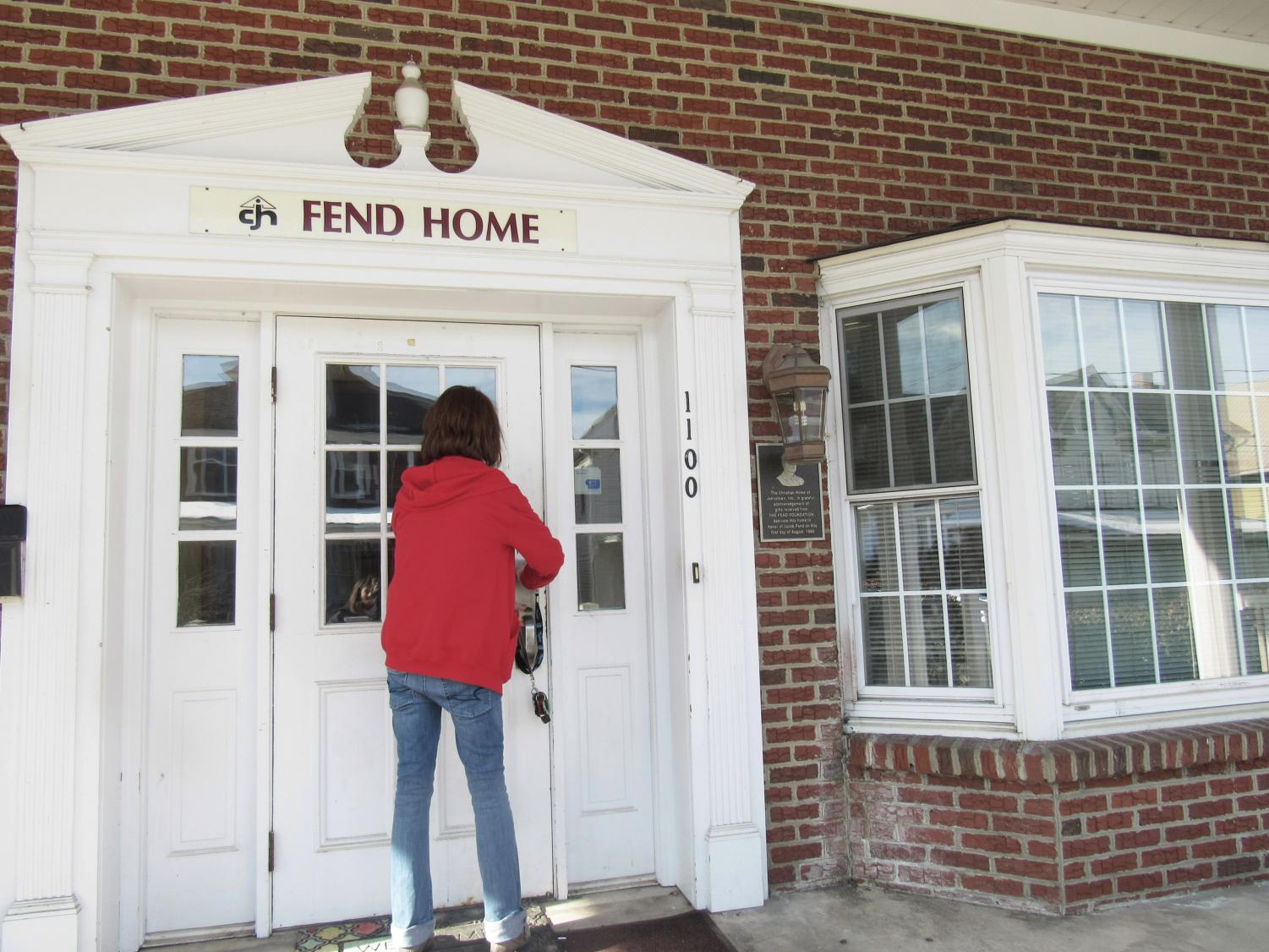 Boy's Home Coordinator Stacey Miorelli unlocks the Fend Home, where the organization's girls find solace.