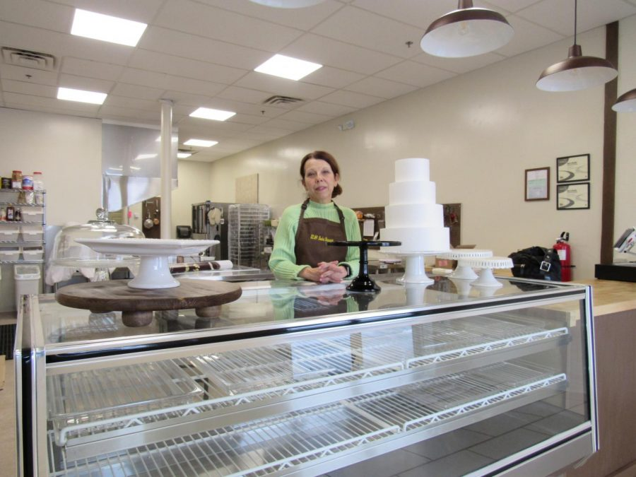 Kim+Asonevich+poses+with+a+cake+in+her+soon-to-open+bakery%2C+%242.49+Bake+Shoppe.+The+Scalp+Avenue+bakery+is+to+be+open+three+days+a+week+until+May.+