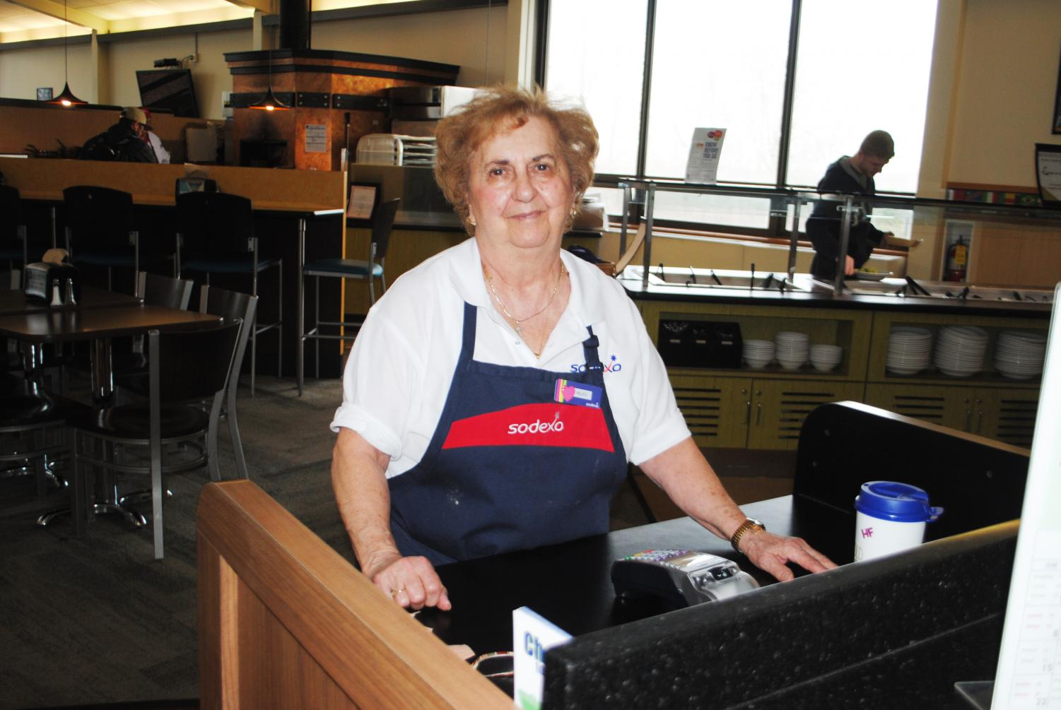 Sodexo worker Helen Ferrante stands, ready with a smile, to swipe students into the Student Union dining hall.
