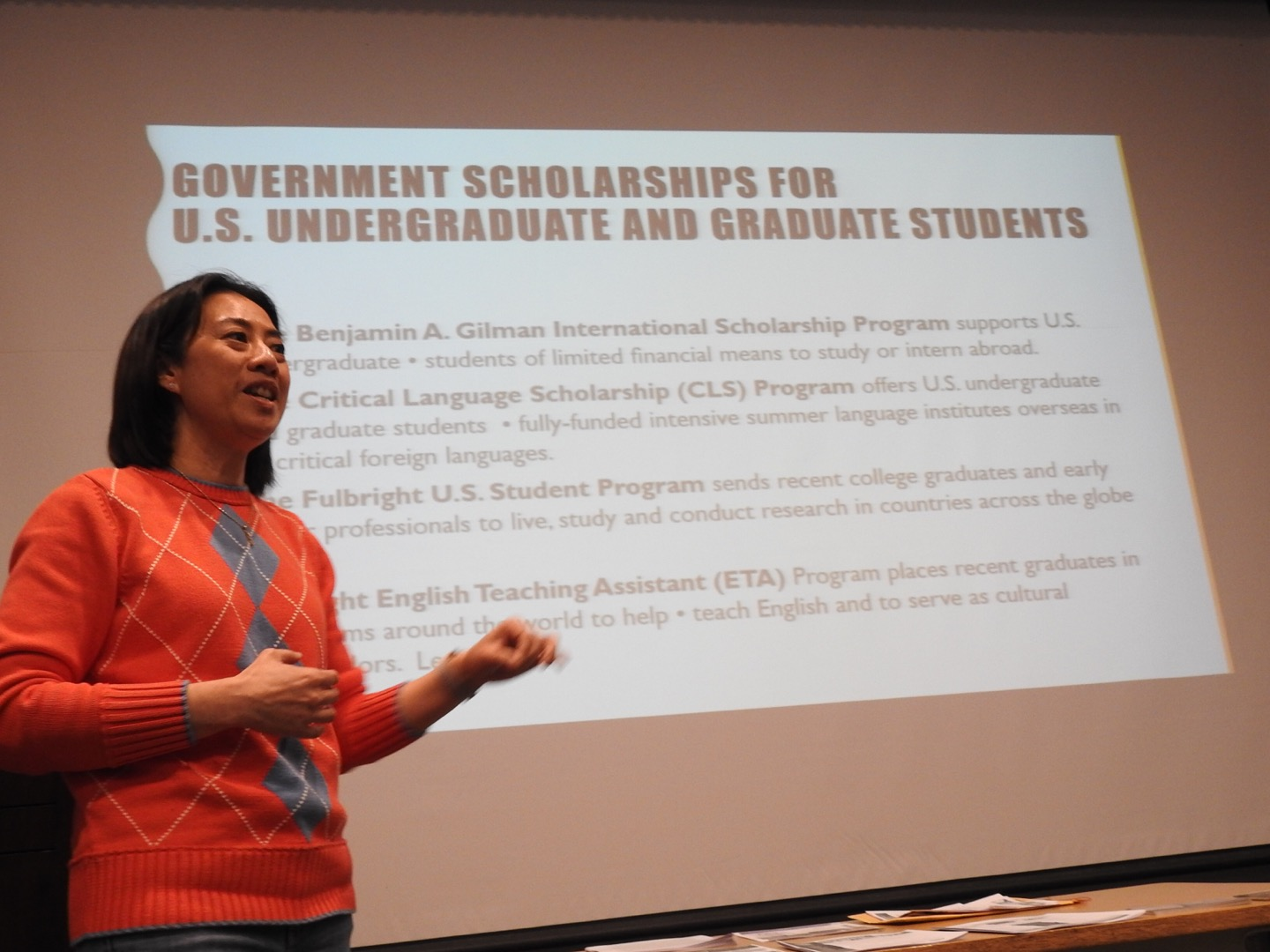 English literature instructor Tuangtip Klinbubpa-Neff tells students about scholarship opportunities at a March 27 study-abroad seminar.