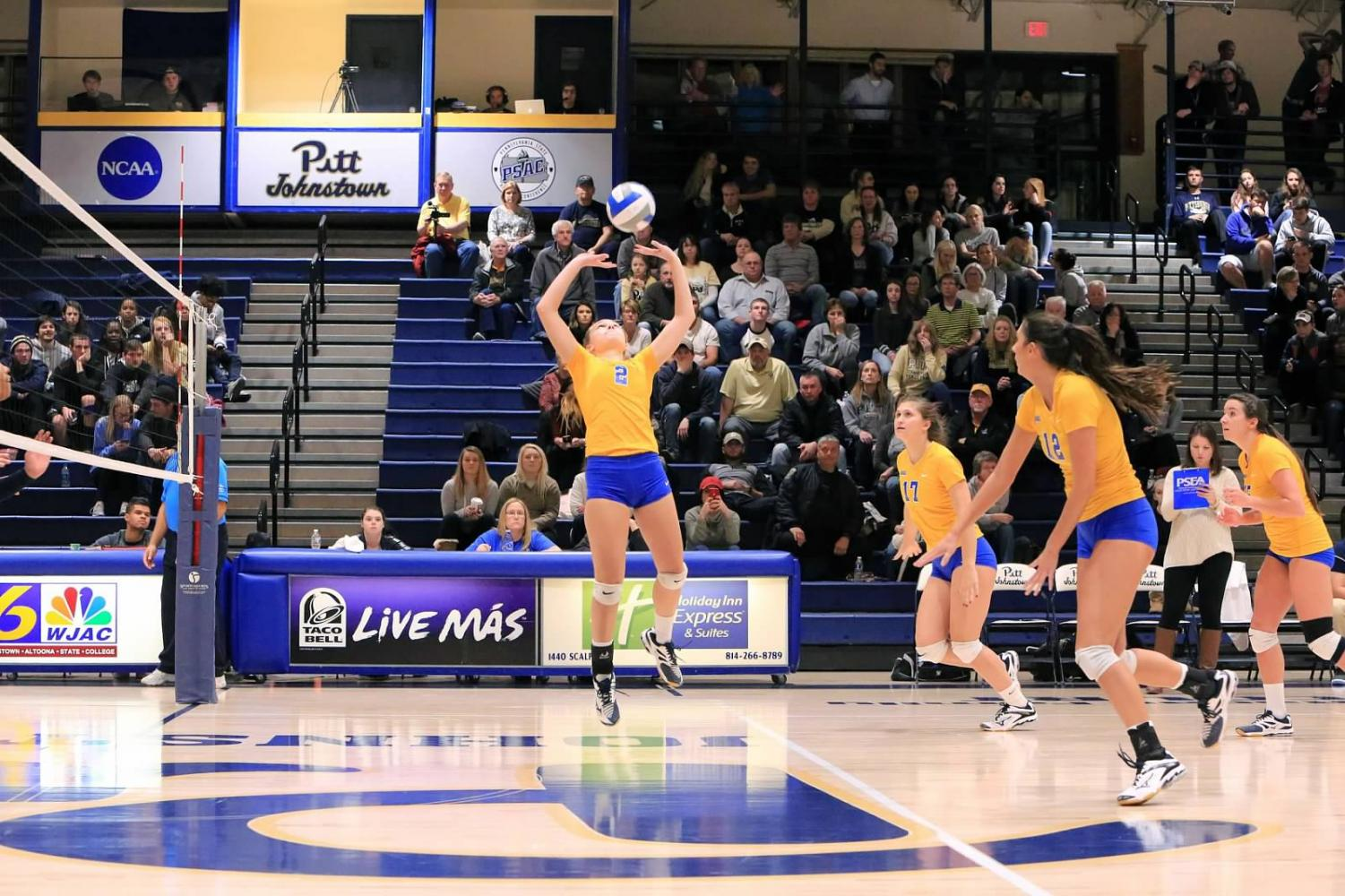 Sophomore J.C. Longeville (center, No. 2) sets the ball up for her teammates at the Sports Center during the conference quarterfinals last season.
