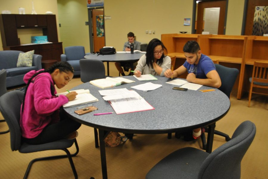 %28Left+to+right%29+Students+Jordyn+Ford%2C+Kaila+Yuazon+and+Muhammad+Quraishy+work+on+math+problems+at+drop-in+tutoring+in+the+Academic+Success+Center+last+week.+