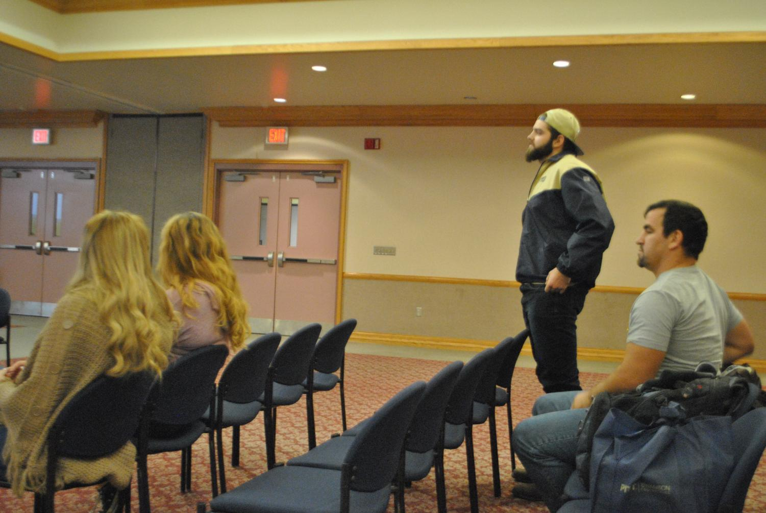 Rugby club President Owen Small discusses with student governors solutions to their fields and gyms dilemma Oct. 22 at the Student Union.