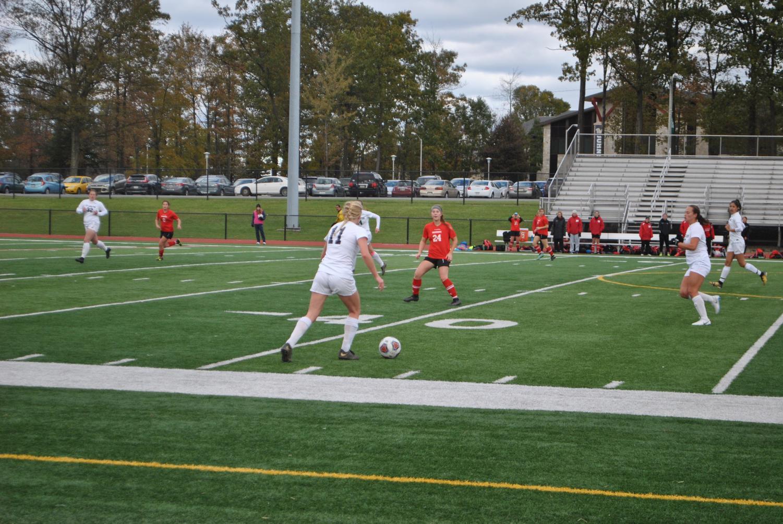 Senior defender Rachel Fleming (11) posses the ball against Edinboro last Wednesday at Richland High School's field. Pitt-Johnstown lost, 0-1.