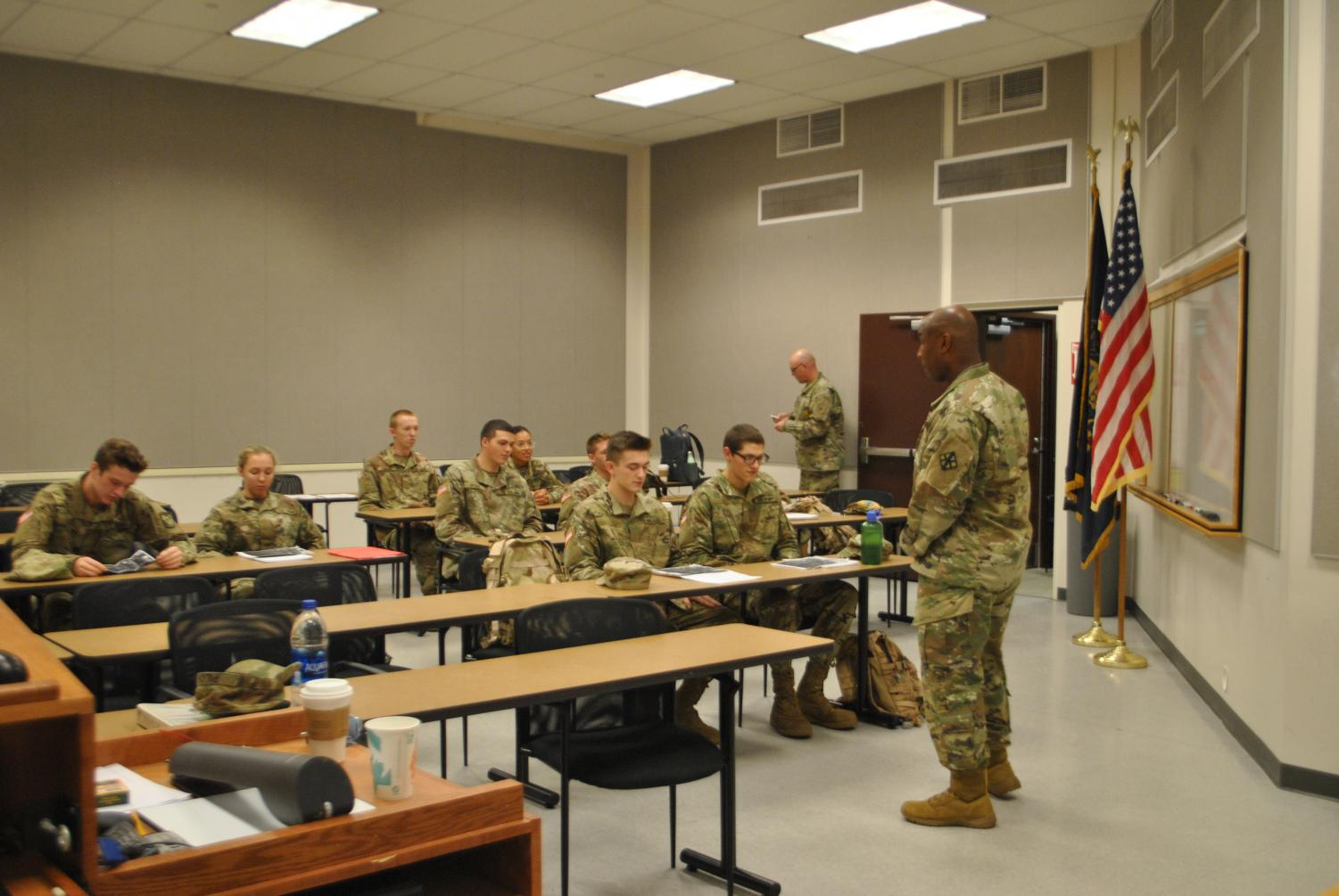 Major Bruce Jordan (right) instructs cadets in their one Pitt-Johnstown lecture, covering topics such as weapons systems and land navigation.
