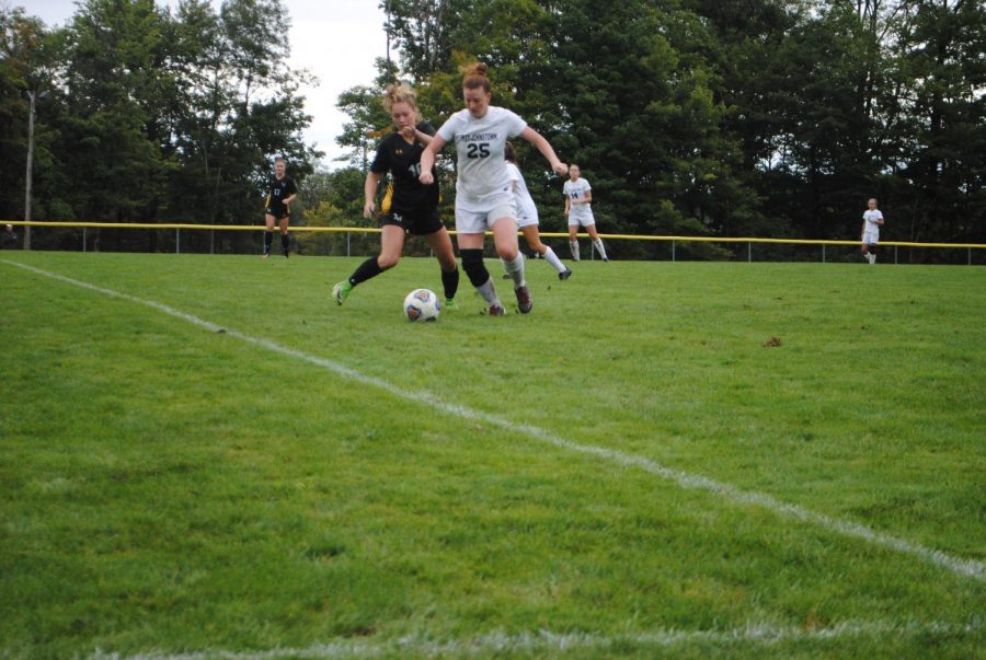 Abby+LaDuke+%28center%2C+white%29+battles+with+a+Millersville+soccer+player+for+ball+control+Sept.+8+at+the+Soccer+Field.+