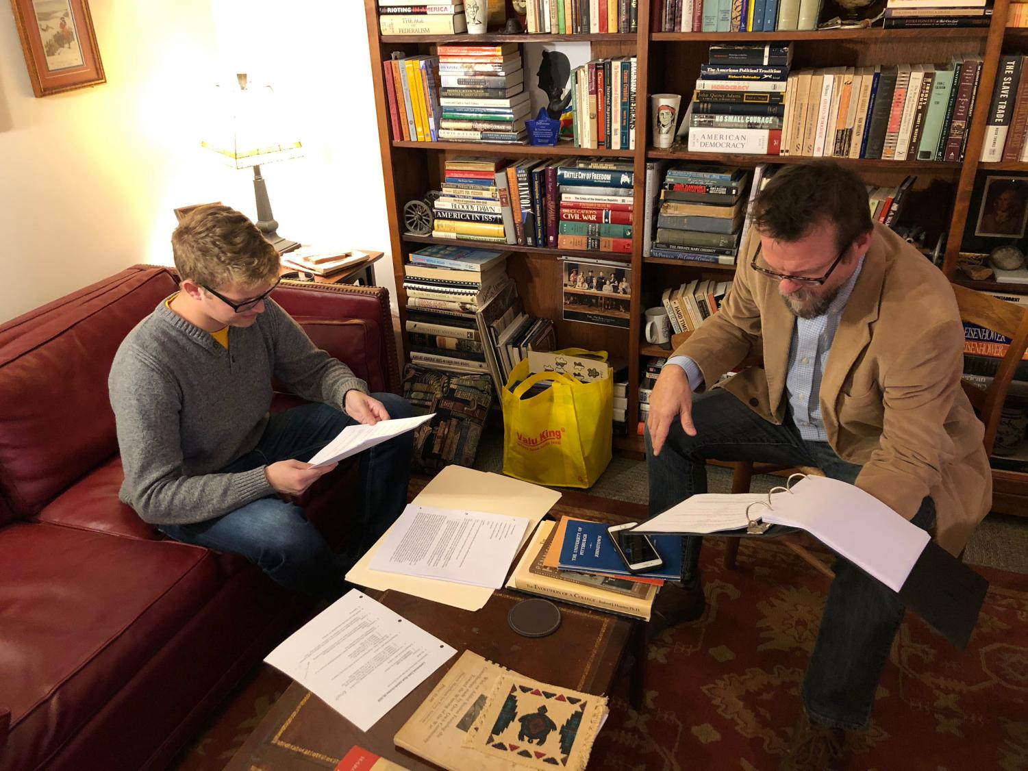 "Senior Sam Miller (left) reads his lines for a major role in ""Canfessional,"" a film in three parts that history professor Paul Newman (right) wrote and is directing for entry in film festivals."