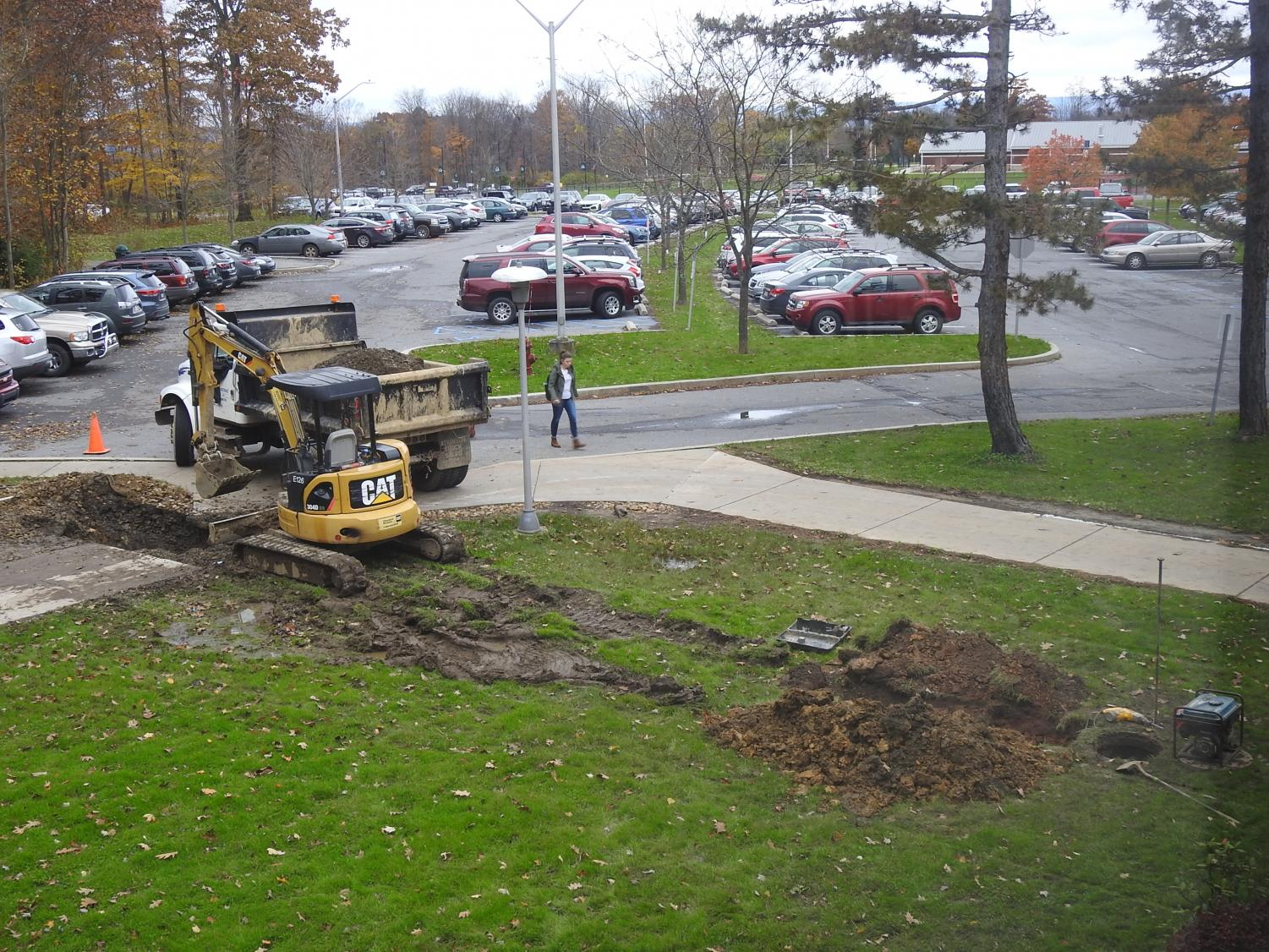 L&M Excavating workers installed a storm drain inlet Nov. 2 to a drainage system near a Biddle Hall sidewalk where water had collected frequently during storms.