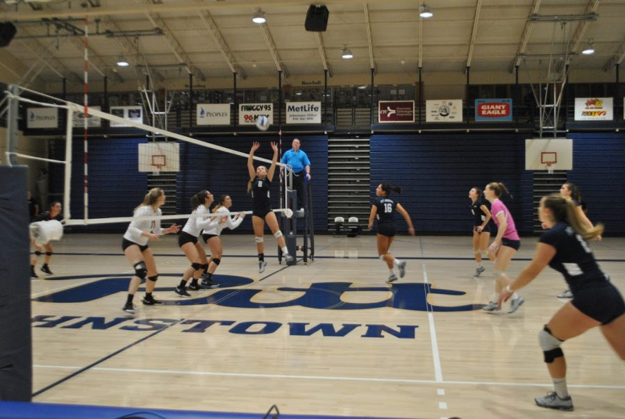 Sophomore+J.C.+Longeville+%28No.+2%2C+center%29+sets+the+ball+for+her+teammates+in+the+volleyball+team%E2%80%99s+first+round+conference+playoff+game+agsinst+California+%28Pa.%29+University+last+Wednesday+at+the+Sports+Center.+The+volleyball+players+lost+2-3.