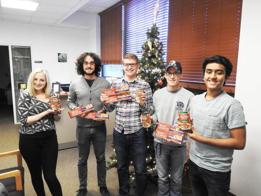 Student+government+members+hold+spaghetti+noodles+and+pasta+sauce+in+the+Student+Union.+They+are+collecting+donated+goods+to+assist+local+families+this+Christmas.+%7C+Photo%3A+Matt+Churella