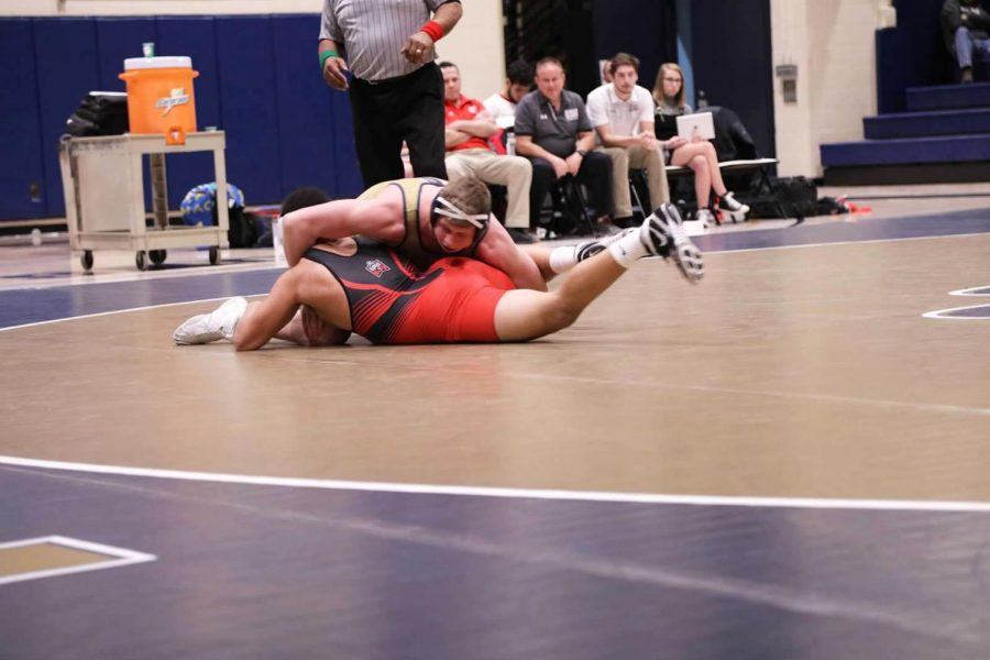 Brock+Biddle+holds+his+opponent+at+a+Jan.+11+bout+at+the+Sports+Center+against+East+Stroudsburg.