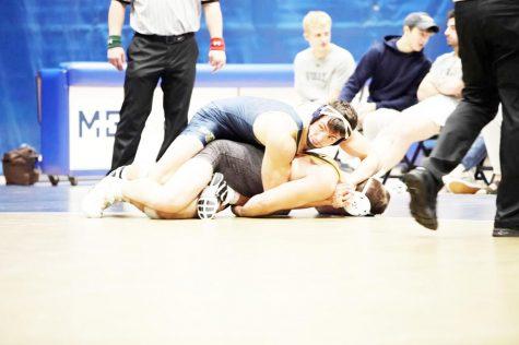Tyler Reinhart dominates on the mat