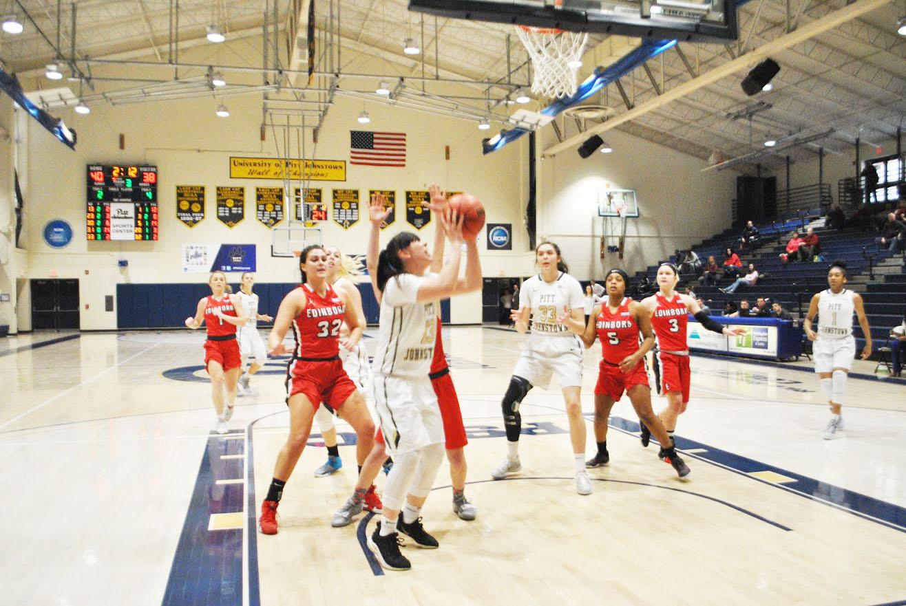 Pitt-Johnstown junior Alli McGrath (No.13) attempts to make a lay-up Saturday against   Edinboro University at the Sports Center. Despite McGrath's 11 points, the Mountain Cats lost, 68-63.