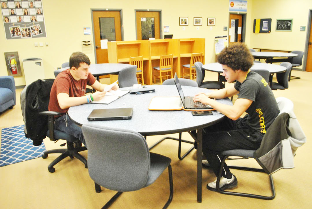 Freshmen Tyler Smith (left) and Jacob Burgette (right) study Jan. 25 at the Academic Success Center in Owen Library.