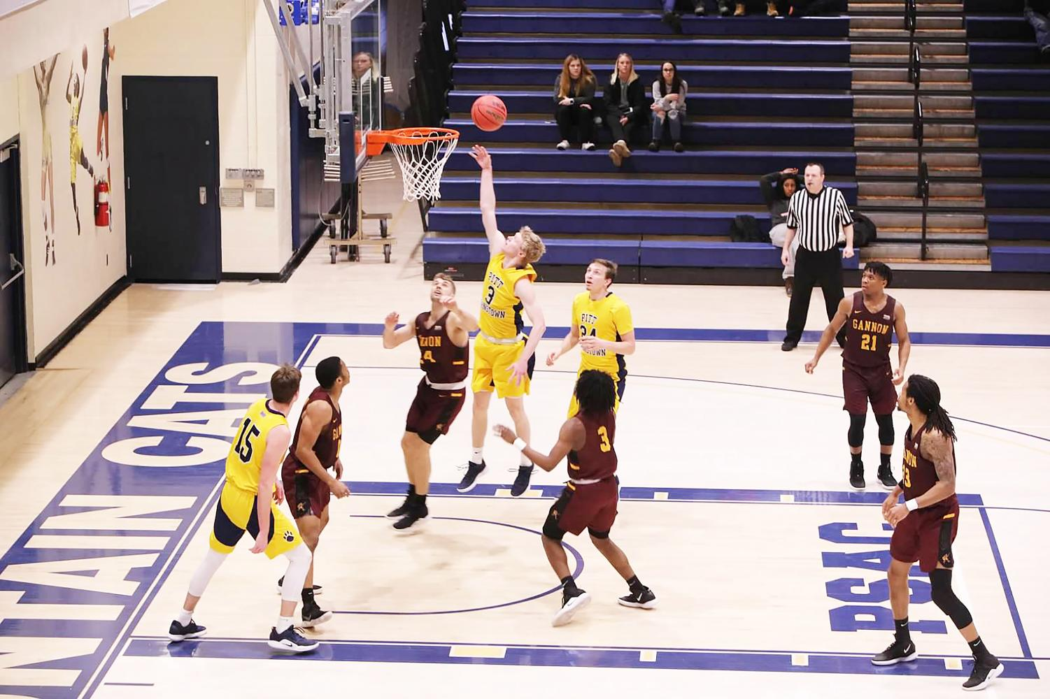 Joe Batt scores with little challenge to help the Mountain Cats defeat the Golden Knights by 11 points Feb. 2 at the Wellness Center.