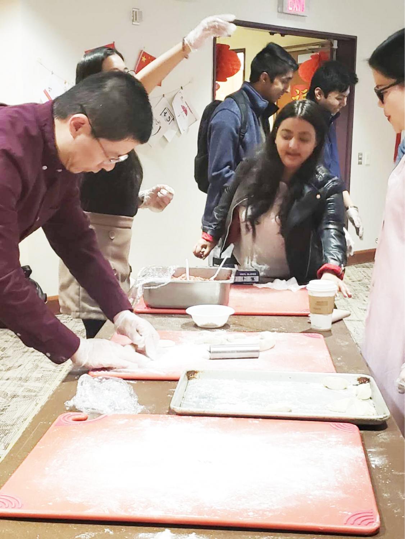 Students make dumplings under instruction at a Feb. 4 Chinese New Year celebration at Pitt-Bradford.    Photo courtesy of Wang Yaxuan.