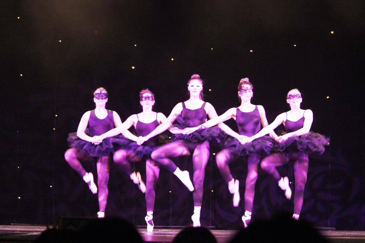"""Senior choreographer Kristin Haydt (center) kicks with dancers in """"Control,"""" the only pointe piece performed at Dance Ensemble's show """"Electricity"""" Saturday night."""