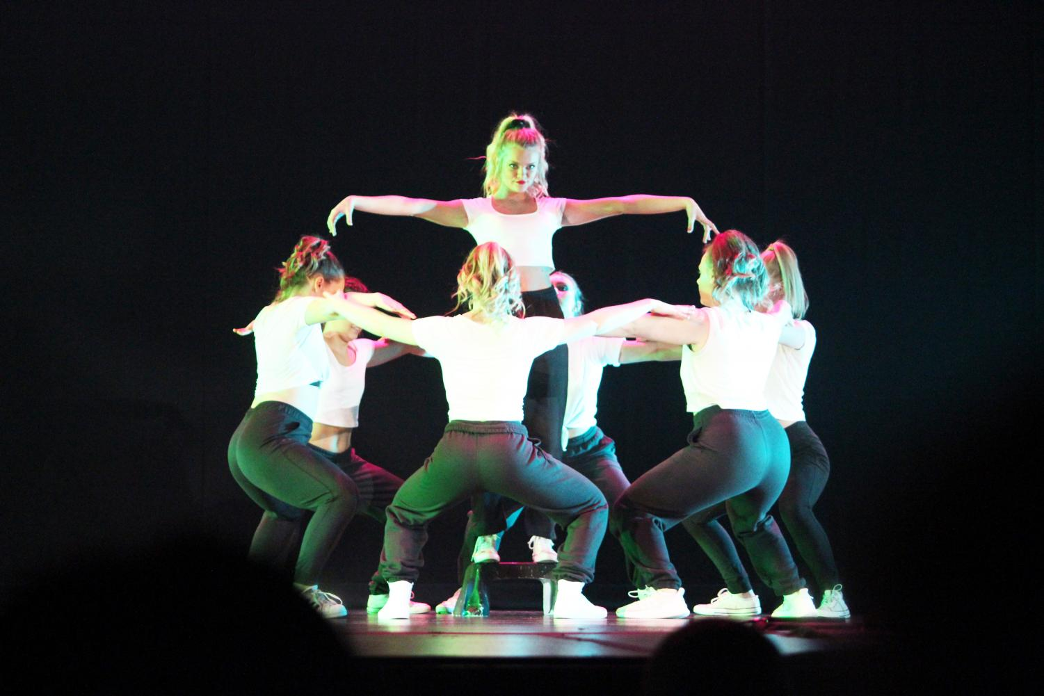 """Michaela McKay (standing) seems to command the stage in """"Lose Control"""" at Dance Emsemble's """"Electricity"""" show Saturday night."""