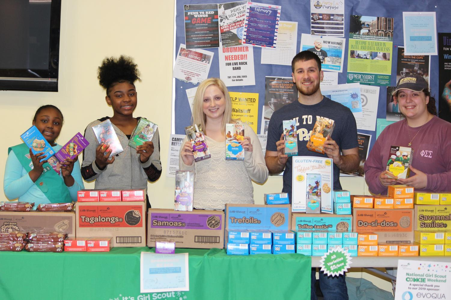 Girl Scout Ariyana Mays (left), junior Madison Kriak (middle) and sophomore Michael Garancsi (right) sold Girl Scout cookies last Friday on the Student Union ground floor.