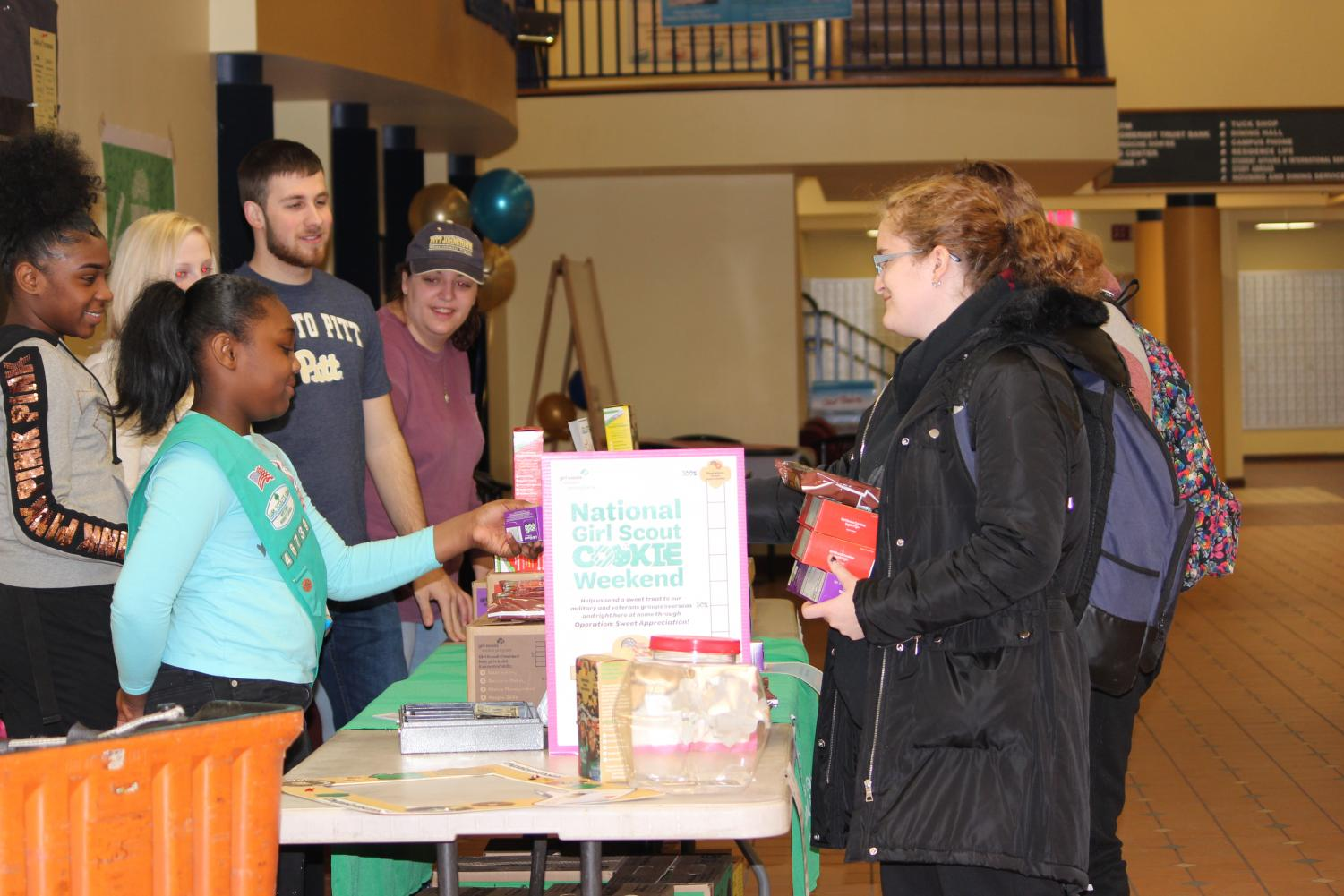Lacey Mays (front), who is a Girl Scout, sold cookies with her sister, Ariyana Mays (left), last Friday in the Student Union.