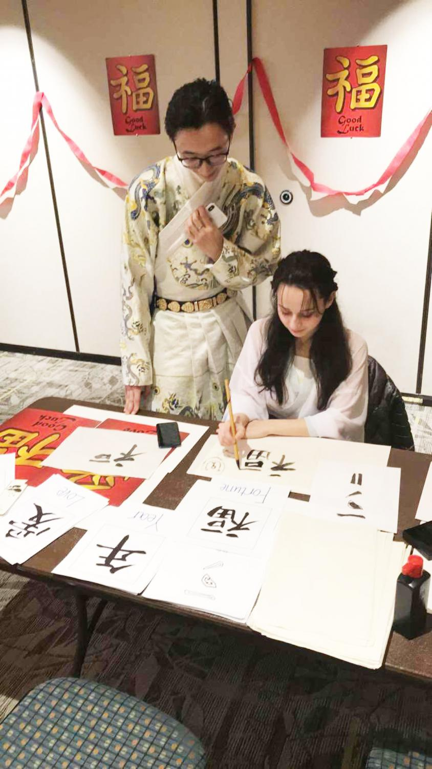 Sophomore Pan Bowen and freshman Hind Albakri practice calligraphy while celebrating Chinese New Year at Pitt-Bradford on Feb. 4.  | Photo courtesy of Hind Albakri