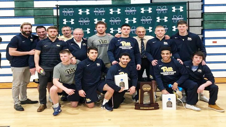Pitt-Johnstown+wrestlers+pose+with+their+regional+trophy+after+winning+their+regional+tournament+Feb.+23+in+Erie%2C+Pa.