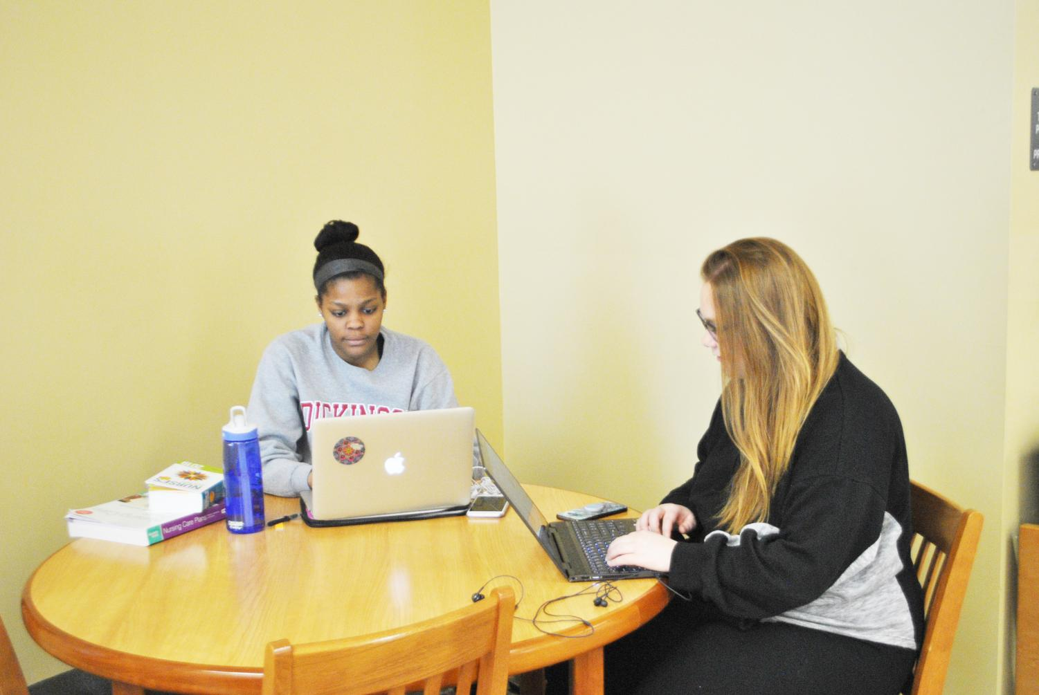 Sophomores Ashley Dean and Abby Bell studied Friday in the Owen Library.