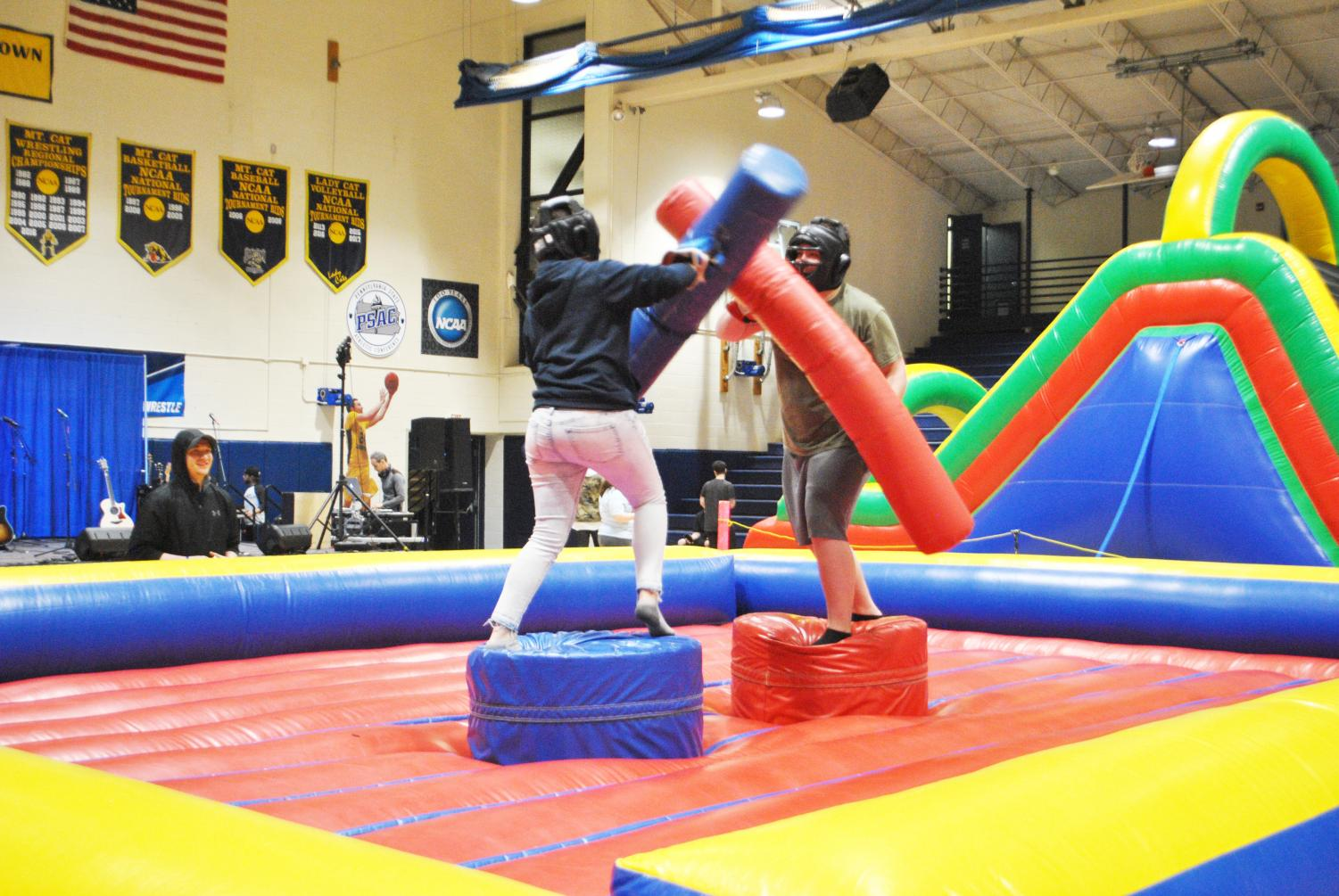Junior Kayla Johnson and senior Patrick Thomas competed in an inflatable combat arena Friday at Program Board's block party.