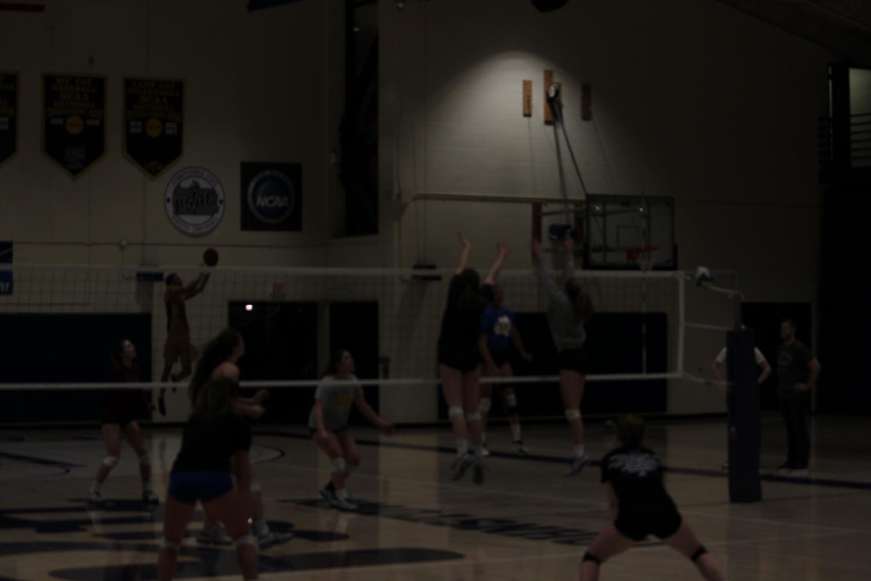 The Pitt-Johnstown women's volleyball team training March 27 in the Wellness Center.